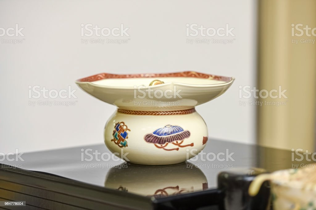 Japanese Tea set on Daisuke - large Cup. The concept of Japanese folk traditions royalty-free stock photo