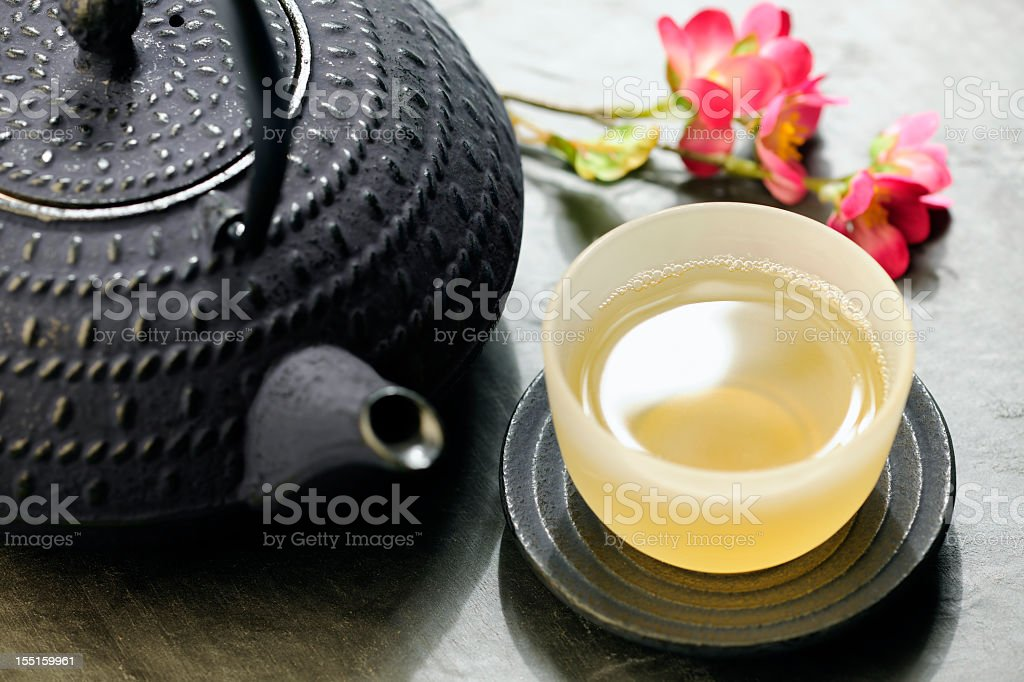 Japanese teapot and cup of green tea stock photo