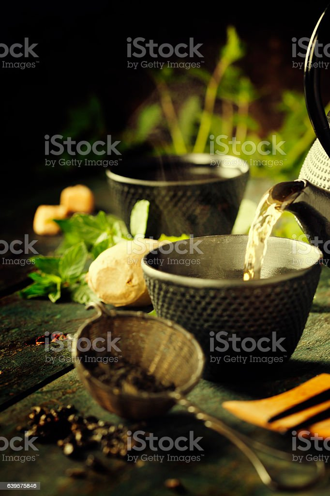 Japanese teapot and cups with mint tea stock photo