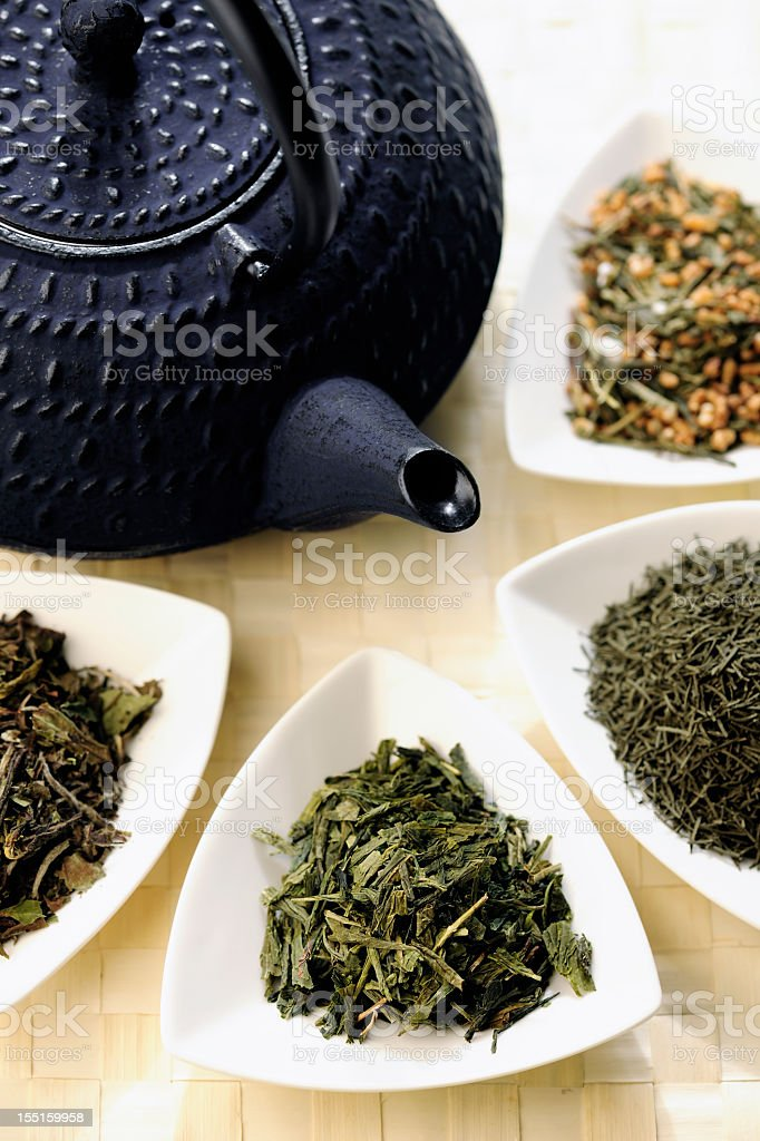 Japanese teapot and different sorts of green tea royalty-free stock photo
