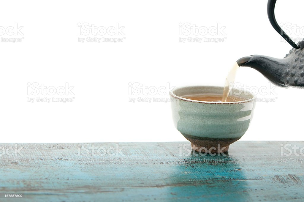 Japanese teapot tetsubin and cup, isolated, white background, copy space stock photo