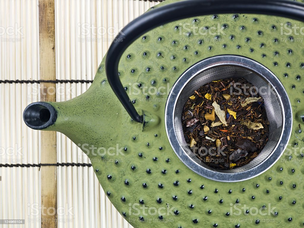 Japanese teapot with tea-strainer full of herbal tea royalty-free stock photo