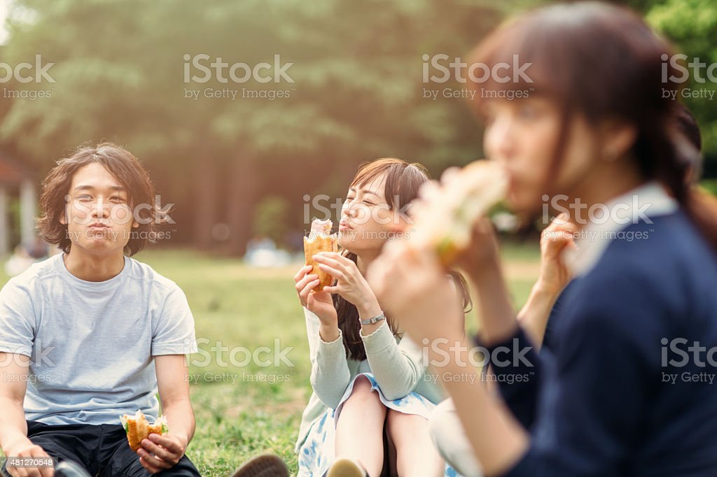 Japanese teenager eating outside stock photo