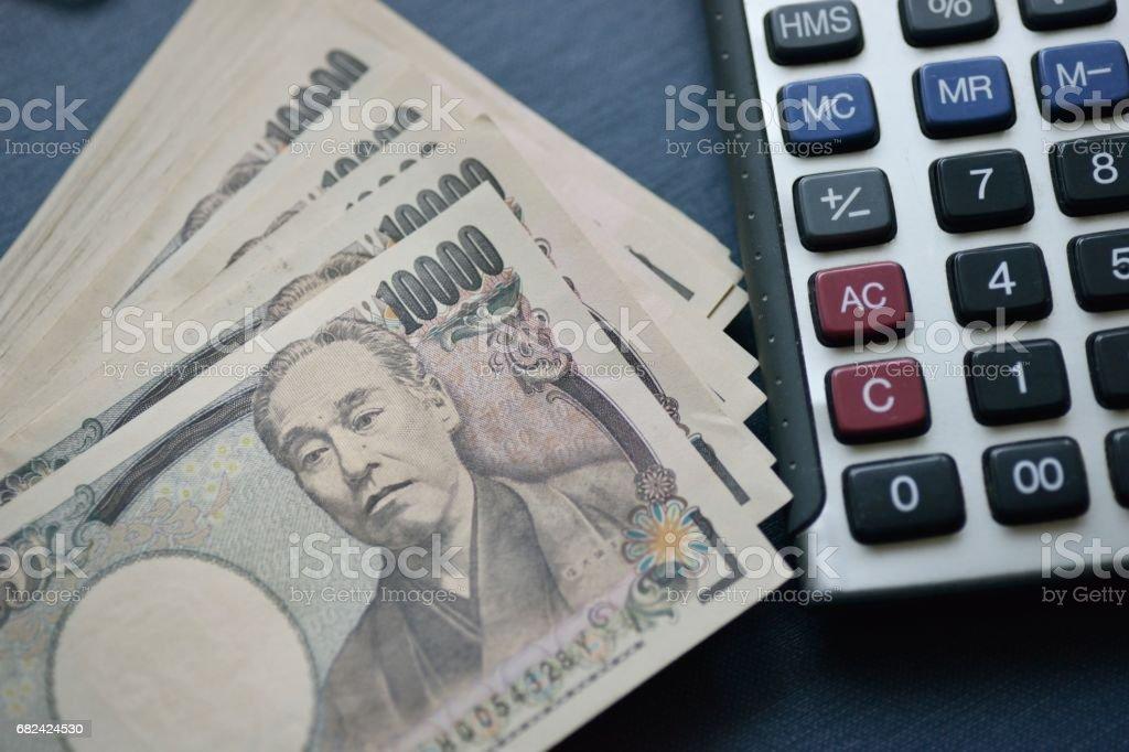 Japanese Ten Thousand Yen Bills And Calculator royalty-free stock photo