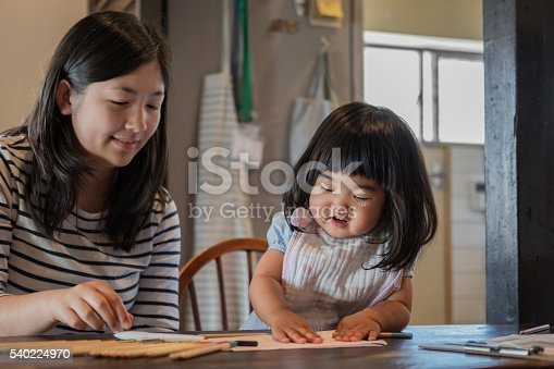 istock Japanese Toddler and Teenaged Girl Drawing and Playing with Paper 540224970
