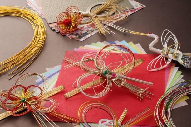 japanese tradition, mizuhiki and japanese paper - мидзухики стоковые фото и изображения