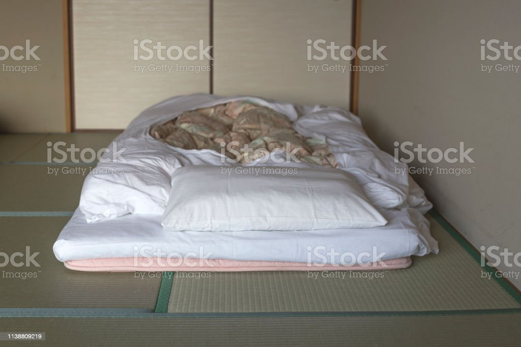 Picture of: Japanese Traditional Bed On Tatami Mats In Japanese Traditional Hotel Stock Photo Download Image Now Istock