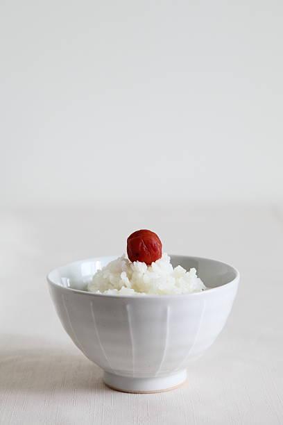 japanese traditional food - rice with pickled plum umeboshi - ご飯茶碗 ストックフォトと画像