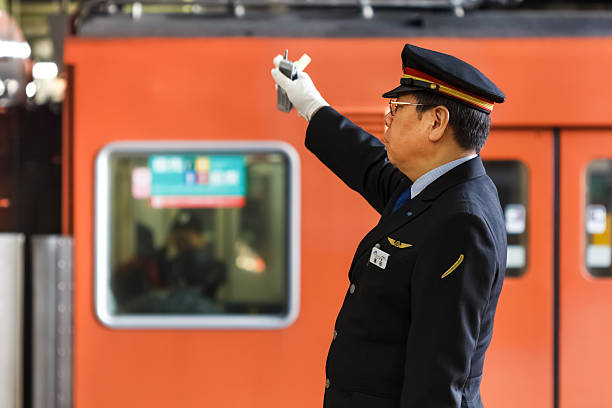 japanese train conductor in osaka - transport conductor stock photos and pictures