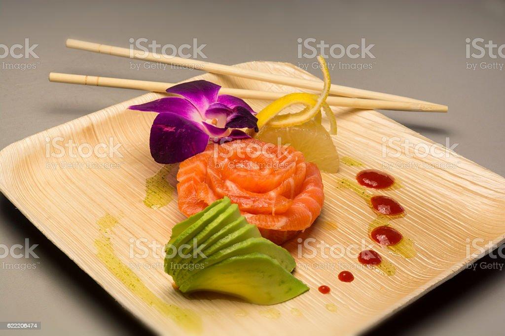 Japanese Tuna Sashimi Sushi With Avacado And Purple Orchid stock photo