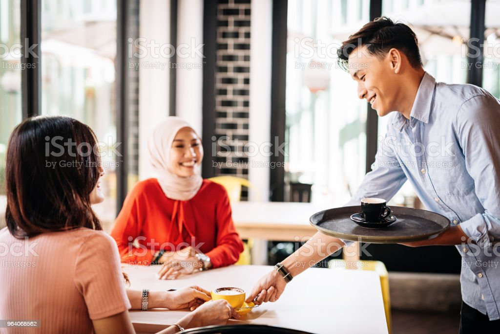 Japanese waiter is serving coffee to guests - Royalty-free 20-29 Years Stock Photo