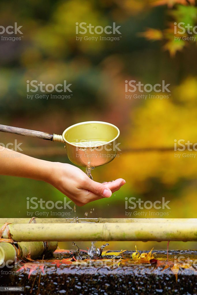 Japanese water purification ritual royalty-free stock photo