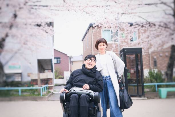 Japanese wife and husband on the Wheelchair Japanese family image in the spring als stock pictures, royalty-free photos & images
