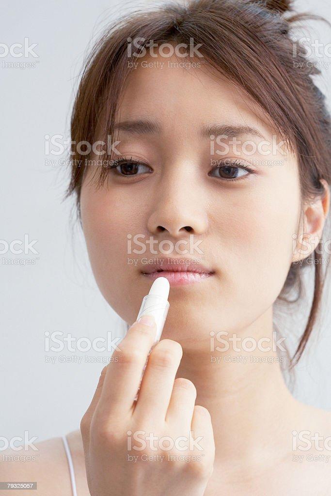 Japanese woman applying lipstick stock photo