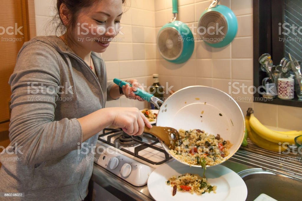 Japanese woman cooking stock photo