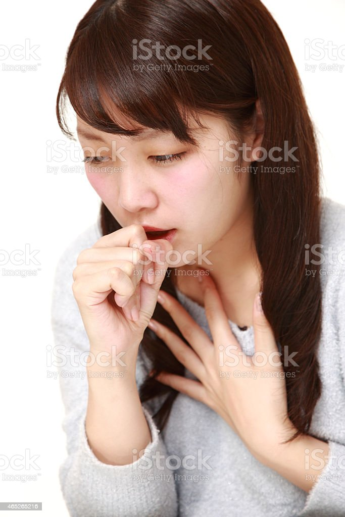 Japanese woman coughing stock photo