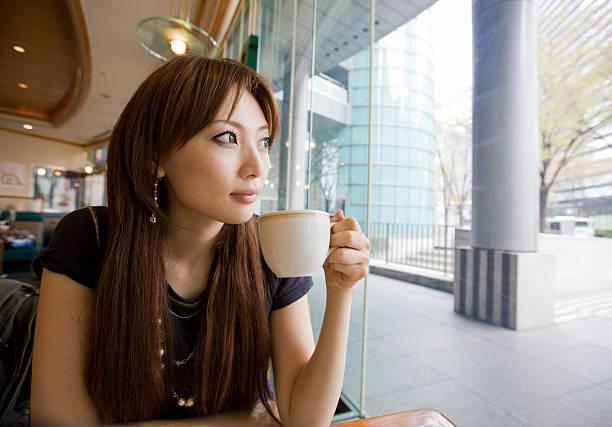 Japanese woman daydreaming stock photo