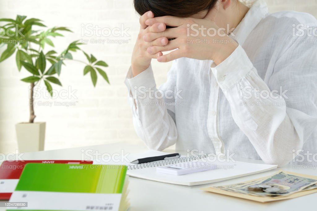Japanese woman depressed by severe living cost Japanese woman depressed by severe living cost Accountancy Stock Photo
