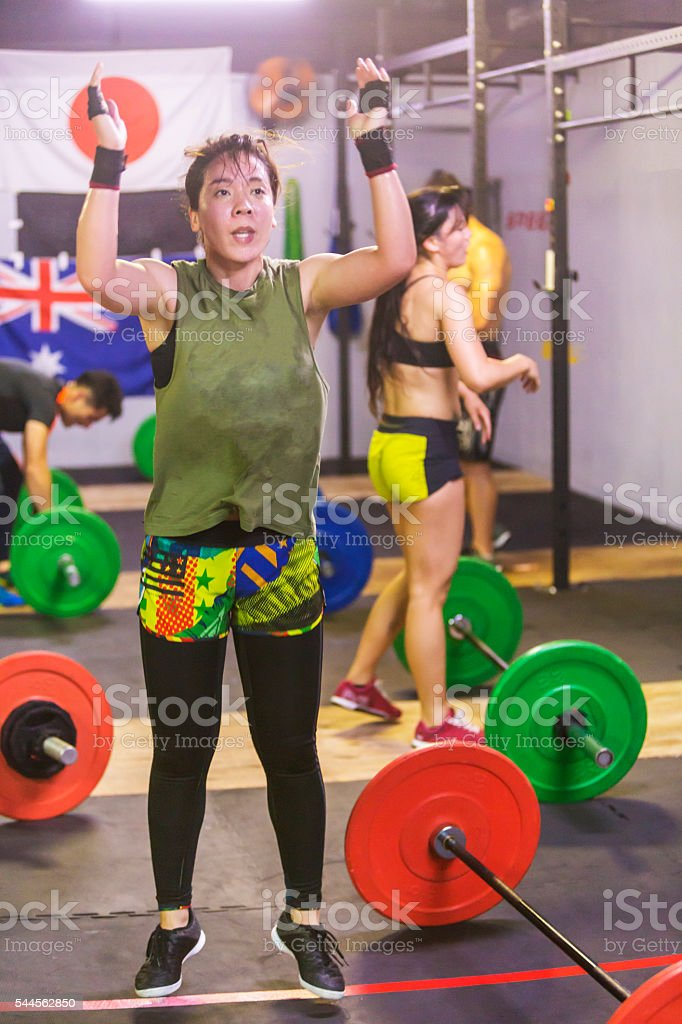 Japanese woman Doing Burpees During a Cross Training Workout stock photo