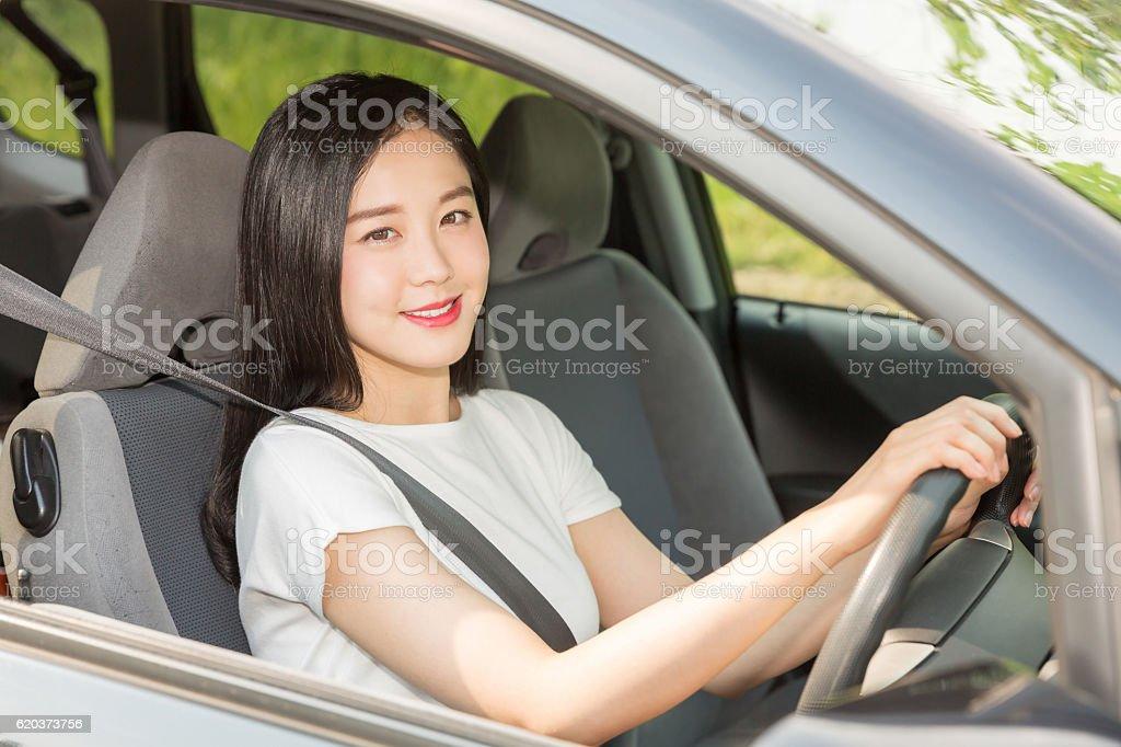 Japanese woman driving a car zbiór zdjęć royalty-free