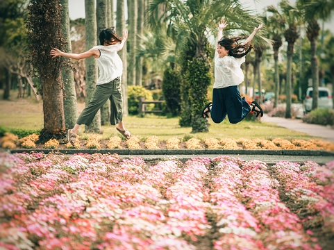 istock japanese woman had stormy hair and jumping 1145466683