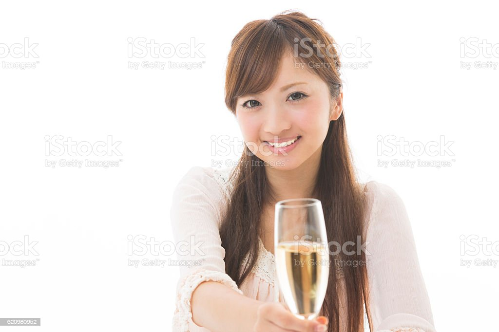 Japanese woman having a glass of prosecco foto royalty-free