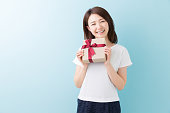 Japanese woman holding a gift box