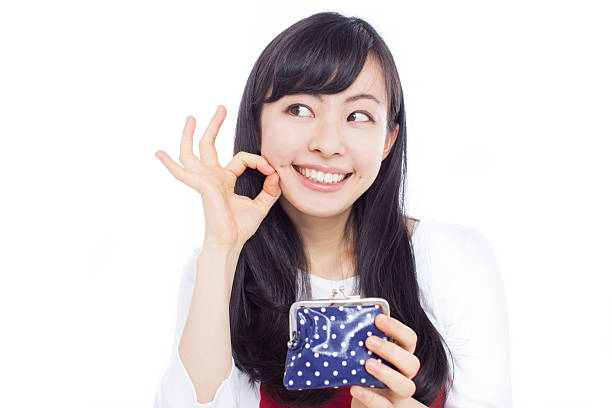 japanese woman holding a purse making gestures - 財布 ストックフォトと画像