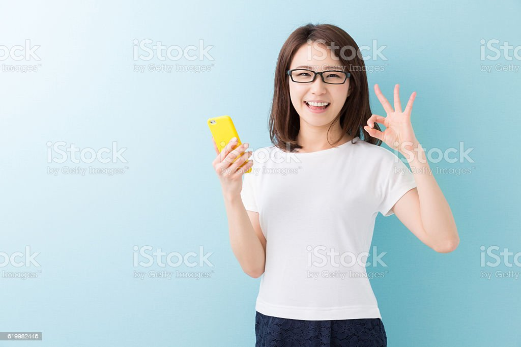 Japanese woman holding a smartphone stock photo