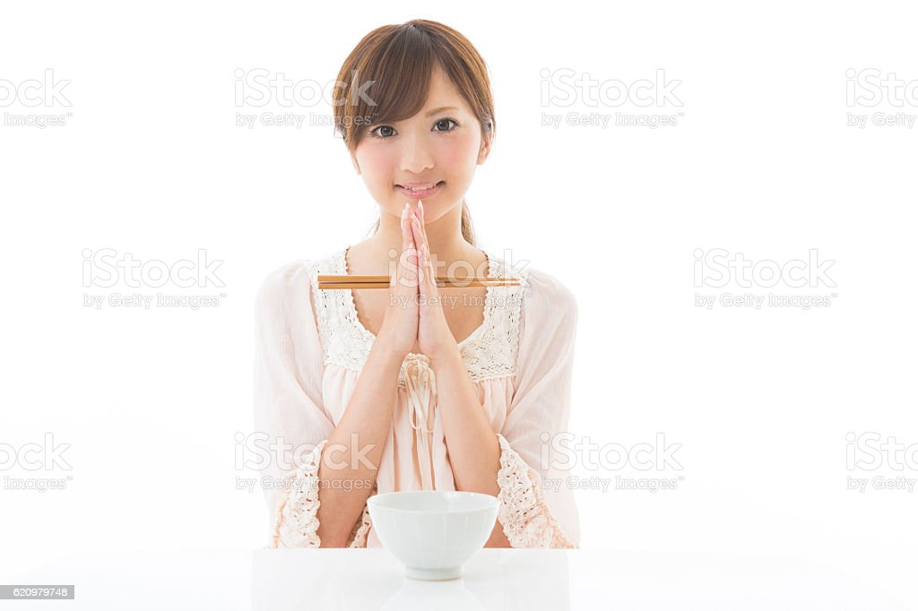 Japanese woman holding bowl and chopsticks foto royalty-free