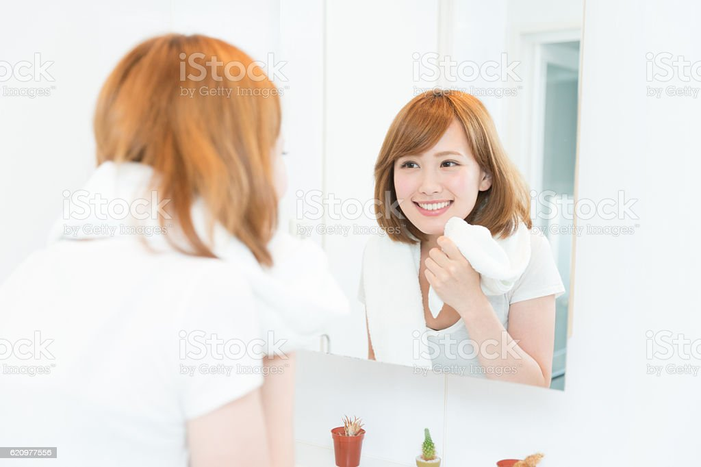 Japanese woman in front of a mirror stock photo