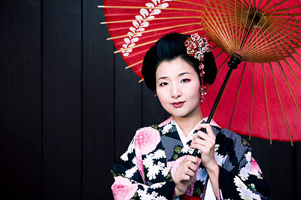 japanese woman in kimono and parasol - geisha girl stock photos and pictures