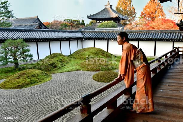 Photo of Japanese Woman in Kimono Appreciating Japanese Garden at Tofukuji, Kyoto