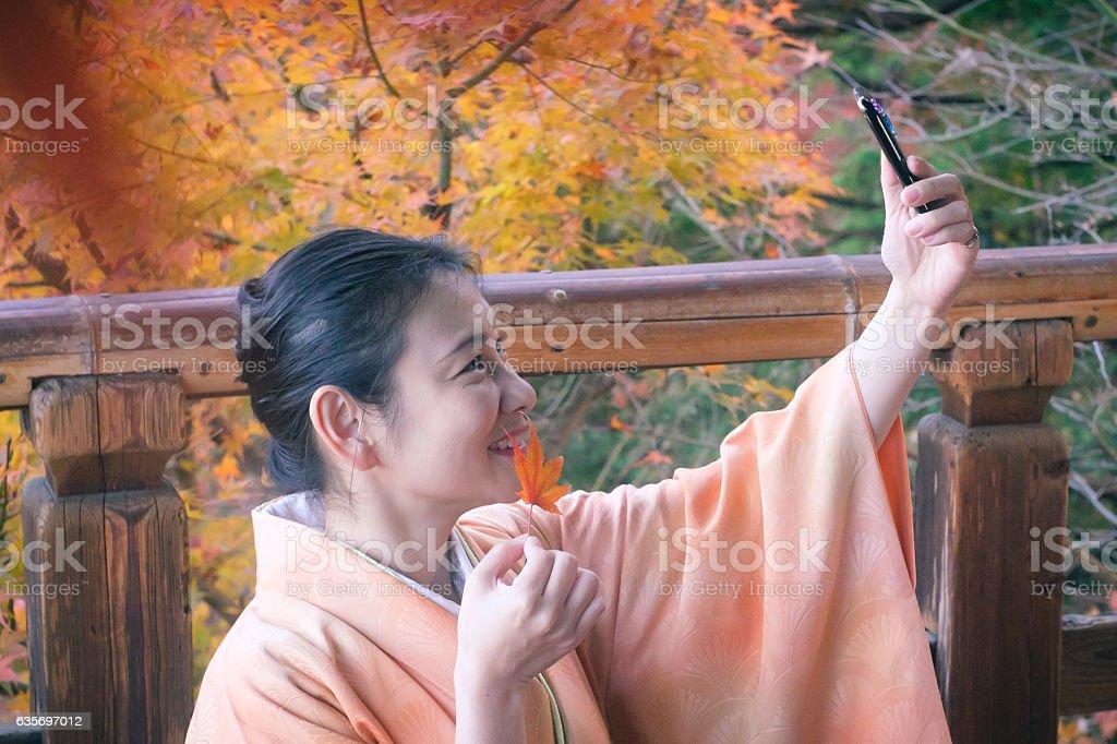 Japanese woman in kimono at Tofuku-ji Temple, Kyoto royalty-free stock photo
