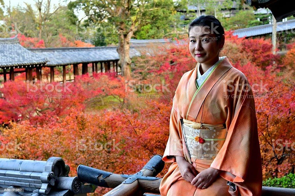 Japanese Woman in Kimono Enjoying Autumn Foliage at Tofuku-ji, Kyoto stock photo