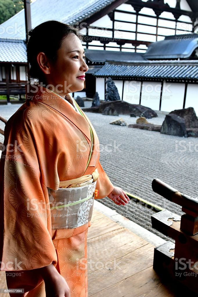 Japanese Woman in Kimono Slowing Walking at Tofuku-ji Temple, Kyoto stock photo