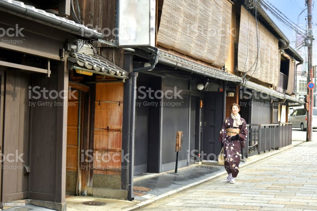 Japanese Woman In Kimono Walking In Old Section Of Kyoto Stock Photo Download Image Now Istock