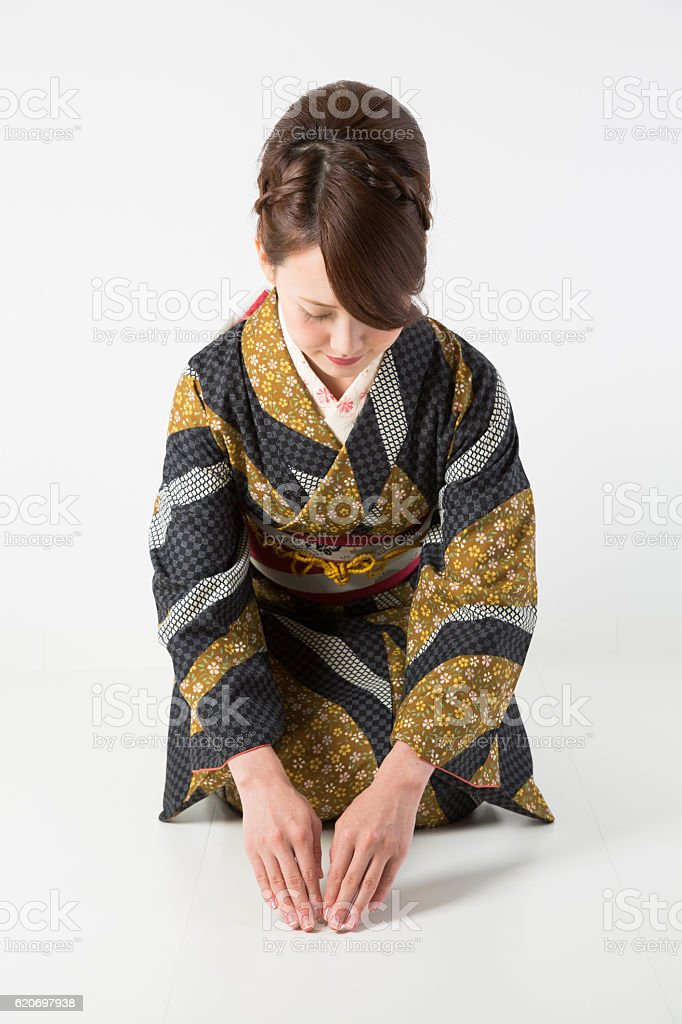 Japanese woman in traditional kimono kneeling ストックフォト