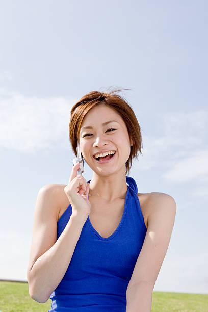 Japanese woman laughing on the phone stock photo
