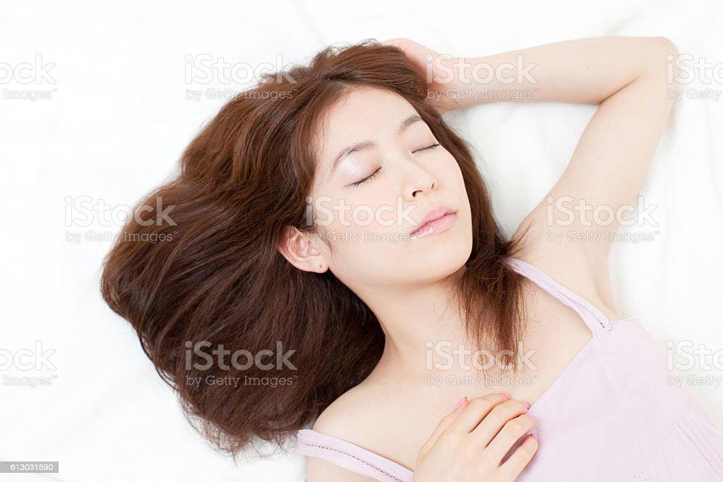 Japanese woman lying down stock photo