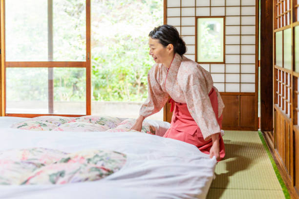 Japanese Woman Making a Traditional Futon Bed stock photo