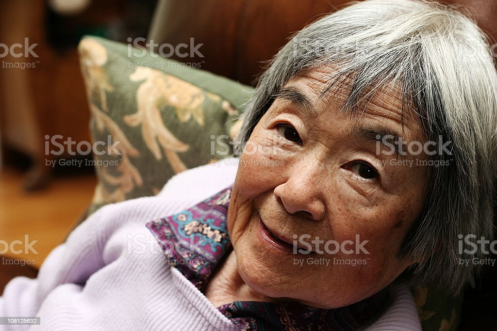 Japanese Woman on the Couch royalty-free stock photo