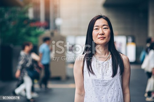 istock Japanese woman outdoors in the city 922663578