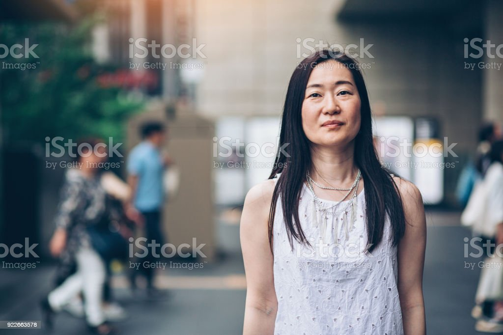 Japanese woman outdoors in the city stock photo