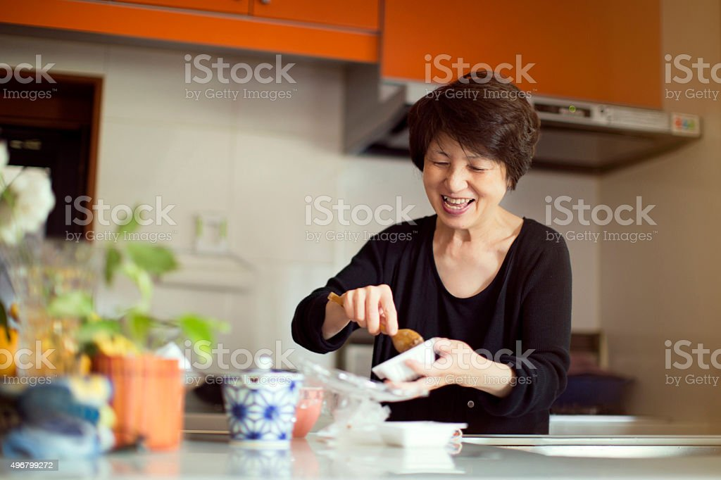 Japanese woman preparing meal stock photo
