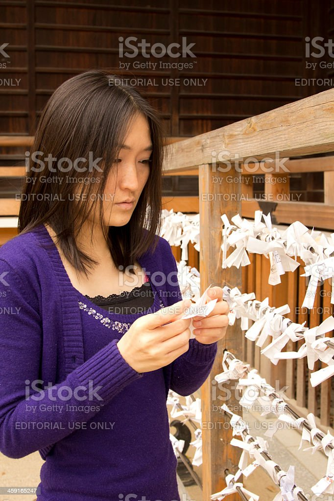 Japanese Woman Reading Her Fortune royalty-free stock photo
