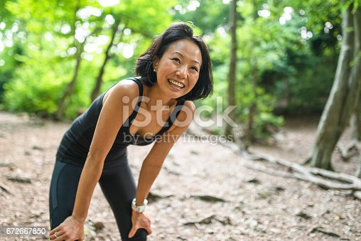 istock japanese woman resting in the wood 672667850