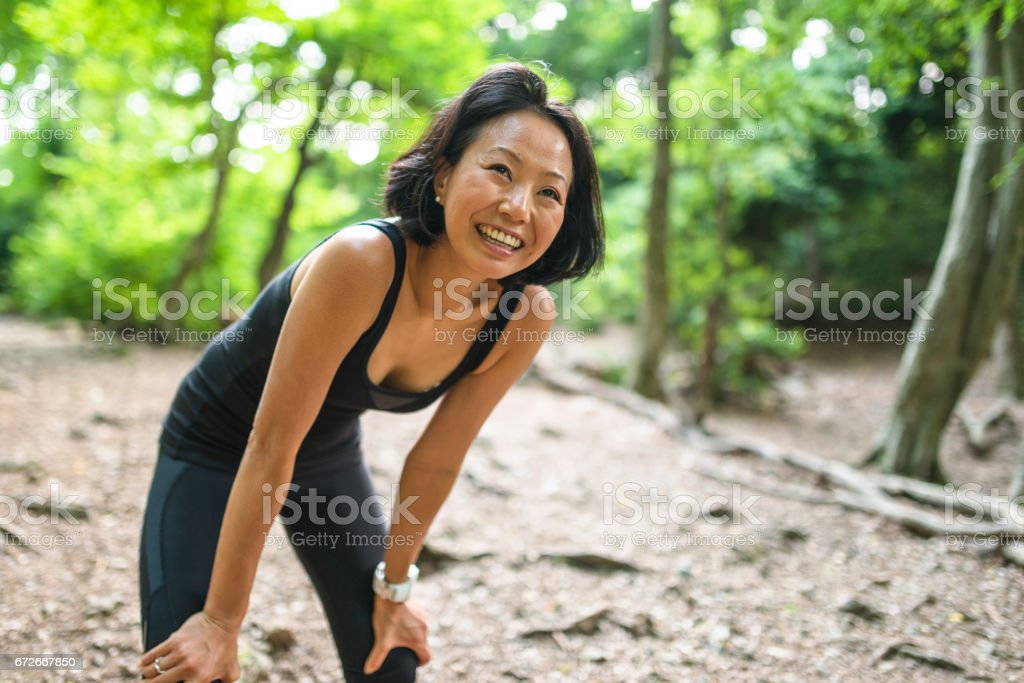 japanese woman resting in the wood stock photo