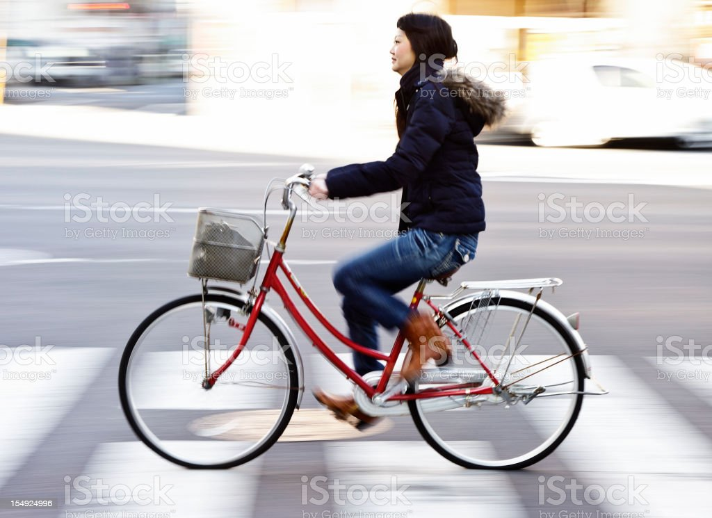 Japanese Woman Riding a Bicycle stock photo