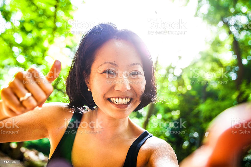 Japanese woman running in mountain in Kyoto City stock photo
